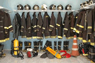 Image of a closet with firemens gear in it