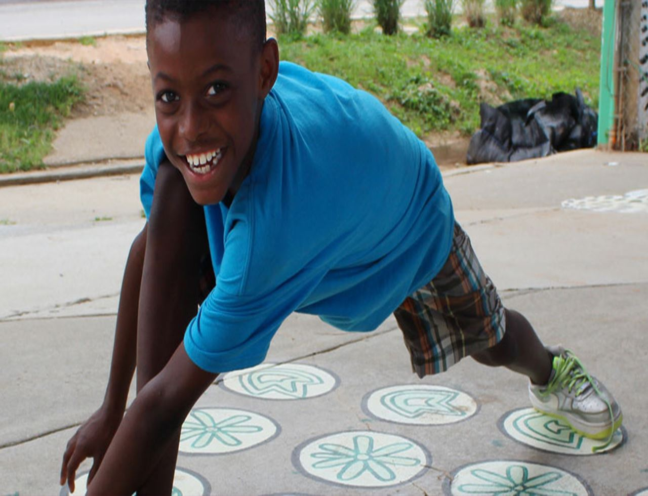 Child playing on interactive sidewalk