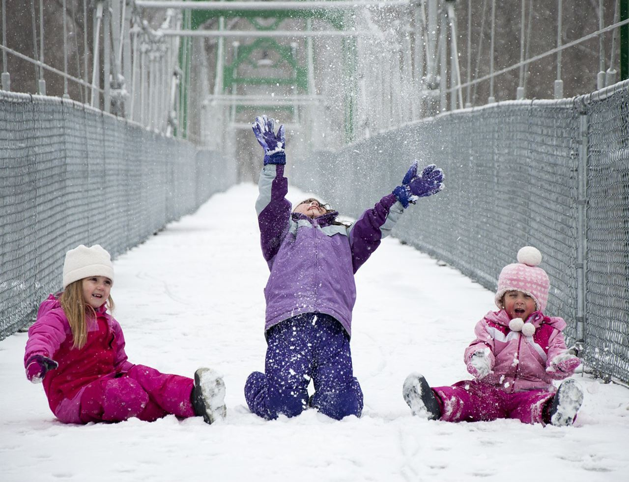 Three girls playing in snow
