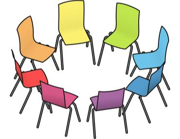 Rainbow colored chairs in a circle