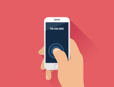 Illustration of a hand holding a phone with the number 734-544-3050 on it