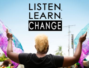 "Image of a woman with her arms up to the sky---above it reads ""Listen, Learn, Change"""
