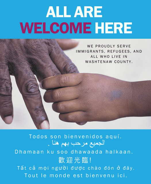 All Are Welcome Here poster with the message all are welcome here in seven languages