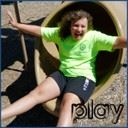 Play and girl in slide